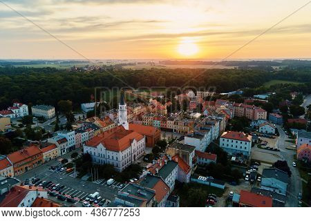 Aerial View Of Old European City. Central Square Of Small Town Cityscape Against Sunrise, Top View