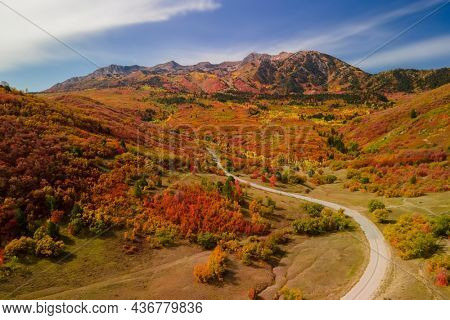 Aerial view of Snow basin in Utah filled with brilliant fall foliage near Mt Ogden