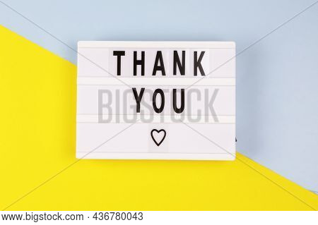 Lightbox With A Words Text Thank You Board On Yellow Blue Background.