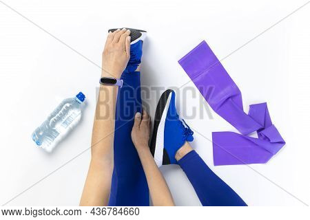 Young Woman Stretching Before Workout, Getting Ready For Pilates Workout. Top View, Isolated White B