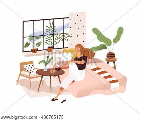 Woman Relaxing At Home, Sitting On Bed At Coffee Table. Happy Person In Modern Cozy Bedroom With Tea