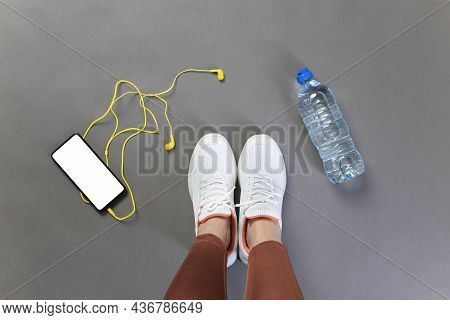 Young Athlete Woman Preparing For Sports In The Gym. Getting Ready For Exercise