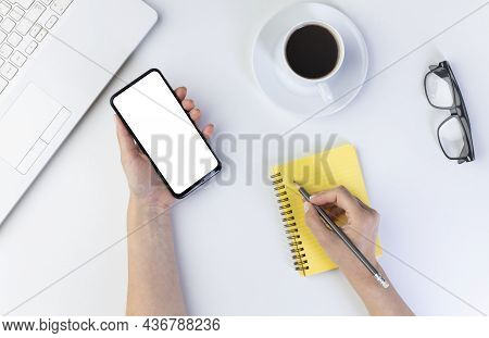 Young Woman Using Mobile Phone With Blank Screen, Business Concept. Mock-up Template For Your Design