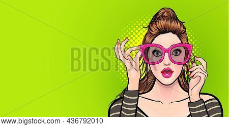 Amazed Young Woman In Glasses Pointing Somthing Pop Art Comics Style.
