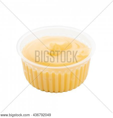 Portion of mayonnaise in a plastic box, angled view, isolated on white background. White sauce or seasoning for food in the package. Template for designers.