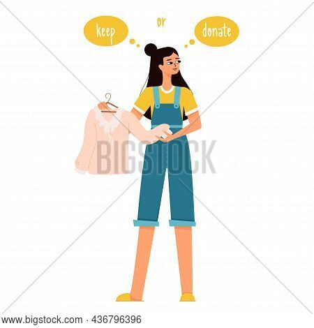 A Young Girl With Dark Hair Is Holding A Blouse In Her Hands And Is Thinking Of Keep It Or Donate It