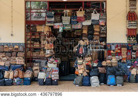 Madeira / Portugal - July 12 2021. Shop Selling Bags Hats And Belts At The Market Area Of Funchal In