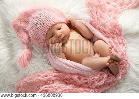 Cute Newborn Baby In Hat Lying On Fuzzy Blanket, Top View
