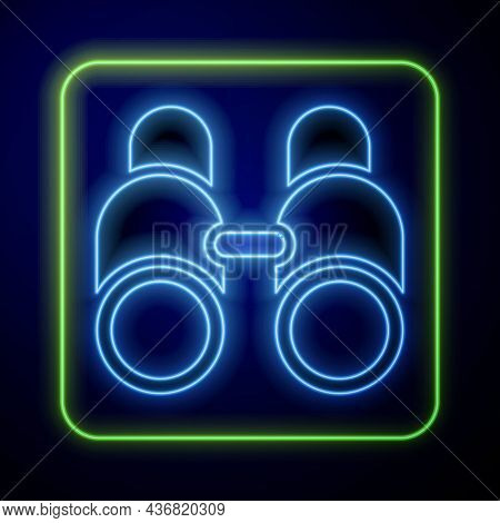Glowing Neon Binoculars Icon Isolated On Blue Background. Find Software Sign. Spy Equipment Symbol.