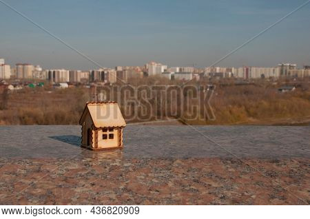 Miniature wooden house outdoor nature. Real estate concept. Modern housing. Eco-friendly energy efficient house. Buying home outside the city Fresh air. Mortgage, loan.