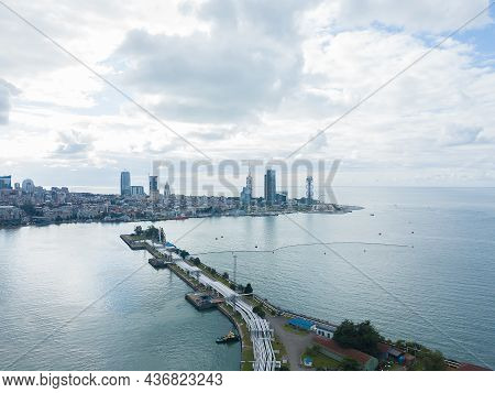 Drone View Of A Part Of The Seaport With Pipes On The Background Of The City Of Batumi