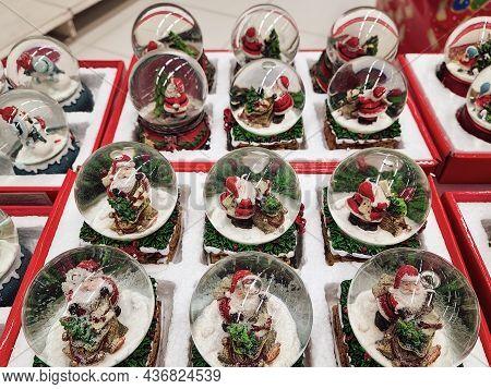 Thessaloniki, Greece - October 19 2021: Christmas Themed Snow Globe Balls On Shelves Of Toy Store. D