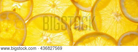 Round Slices Of Fresh Juicy Orange On A Luminous Light Surface. Healthy Food Concept
