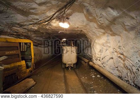 Hutch Cart With Raw Material Standing At Underground Mining. Production And Technology Concept. Tunn