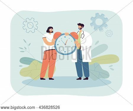 Happy Doctor And Patient Holding Alarm Clock. Woman And Man In Uniform Setting Time For Medication O