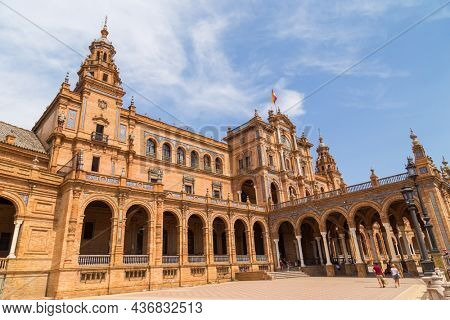 Sevilla, Spain - August 12, 2021. The Spain Square Plaza de Espana in Seville, towers and main entrance to the building. Example of Moorish and Renaissance revival.