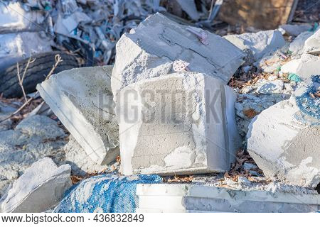 Concrete Debris, Pieces Of Cinder Blocks And Other Construction Waste. Illegal Dump Of Construction
