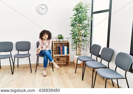 Young middle east woman desperate sitting on chair at waiting room