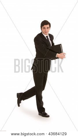Businessman Walking With A Folder