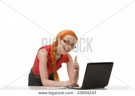 Smiling Woman In Glasses Giving Thumbs Up
