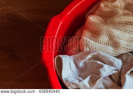 Red Basin With Linen On A Wooden Background. . High Quality Photo