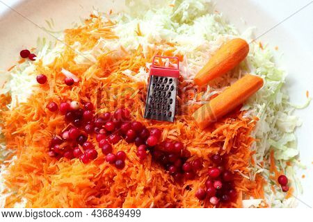 The Concept Of Cooking Cabbage For The Winter. Carrots And Cranberries , Grater, Shredded Cabbage ,