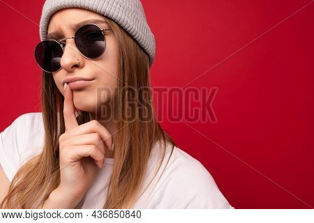 Closeup Of Adult Emotional Thinking Dreaming Beautiful Dark Blond Woman With Sincere Emotions Wearin