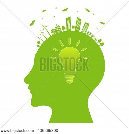 Silhouette Of A Human Head With Electric Lamp Inside. Ecological Idea. Green City With Renewable Ene