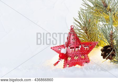 Christmas Background With Red  Christmas Star With Lights Glowing Inside And Pine Green Branch In Br