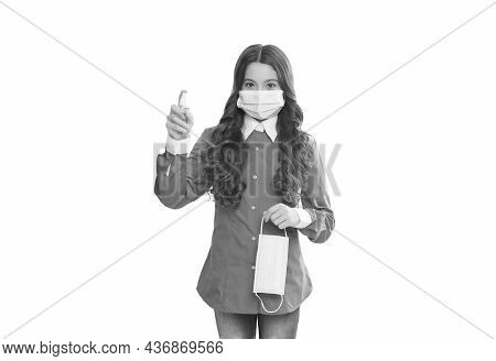 Doctor Girl Use Alcohol-based Hand-washing Spray. Teen Child In Respirator Mask. Preventive Hygiene