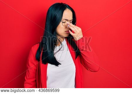 Beautiful hispanic woman with nose piercing wearing casual look and glasses tired rubbing nose and eyes feeling fatigue and headache. stress and frustration concept.