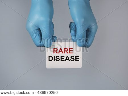 Rare Disease Concept. Word On Paper In Hands.