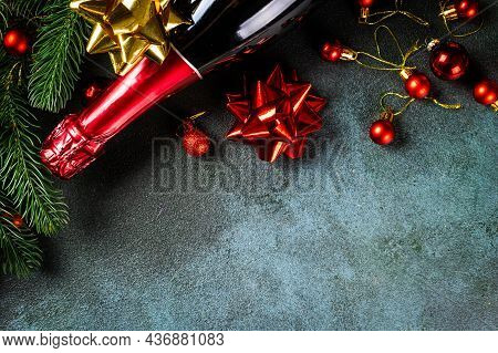 New Year Composition With Champagne Bottle And Christmas Decor. New Year Flatly. Christmas Flatlay.
