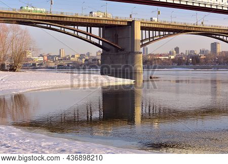 Novosibirsk, Siberia, Russia-03.10.2019: Bridges Over The Ob, Arched Span, Snow And Ice On The Shore