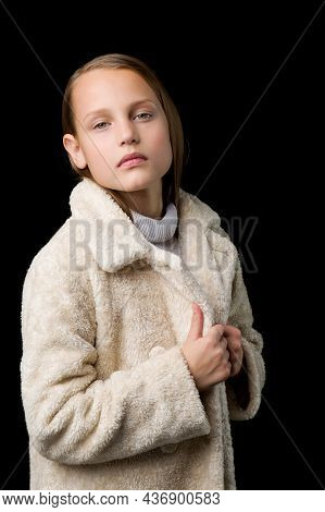 Close Up Portrait Of Stylish Preteen Girl. Beautiful Fashionable Blonde Girl Wearing Beige Faux Fur