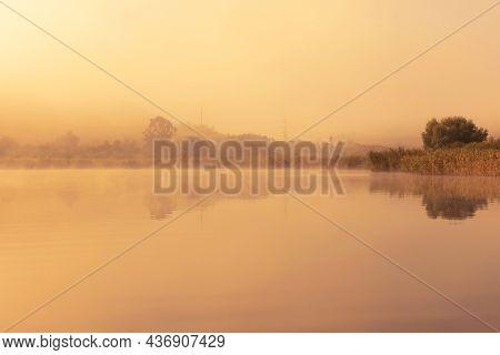 Orange Light Of Sunset Over Sacalaia Lake In Transilvania