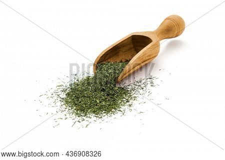 Dry dill leaves in wooden scoop on white background