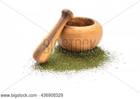 Dry dill leaves near mortar and pestle on white background