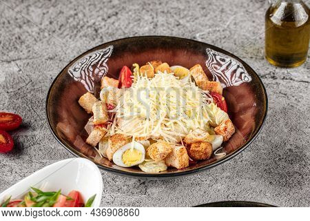 Portion Of Caesar Salad With Cheese And Croutons