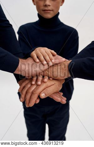 Crop Close Up Image Shot Of Three Generations Of Men Stack Hands, Isolated On White Studio Backgroun
