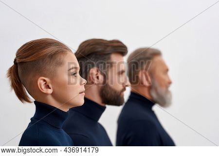 Three Generations Of Caucasian Men Faces In Row Line Isolated On White Studio Background. Little Boy