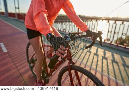 Close Up Of Sporty Active Fit Female Cyclist In Sportswear Ride Bicycle Train Outdoors. Toned Woman