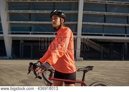 Sporty Toned Woman Cyclist Biker In Sportswear Gear Ride Bicycle Outdoors. Active Fit Girl Follow He
