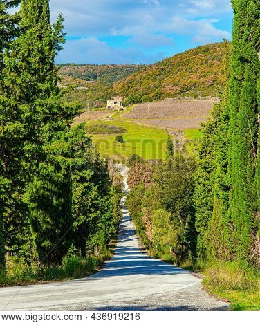 Abbey of Sant Antimo. Magnificent Italy. Charming abbey among vineyards and fields. The magical beauty of the province of Tuscany. Sunny day at the beginning of winter.