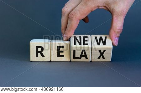 Relax And Renew Symbol. Businessman Turns Cubes And Changes The Word 'relax' To 'renew'. Beautiful G