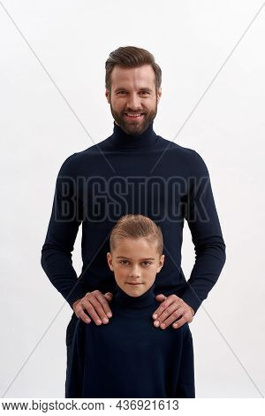 Narrow Vertical Shot Image Portrait Of Smiling Young Caucasian Father And Teen Son On White Studio B