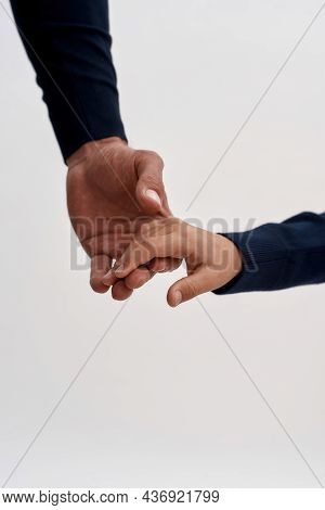 Narrow Vertical Show Crop Image Of Young Father And Small Son Hold Hands Isolated On White Studio Ba