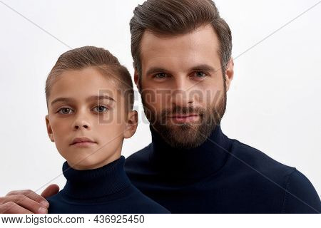 Close Up Portrait Of Young Caucasian Father And Teen Son On White Studio Background Show Family Unit