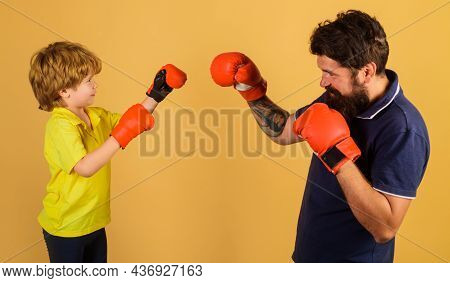 Kid In Boxing Gloves Training With Coach. Punching Knockout. Childhood Activity. Trainer Teaching Ch