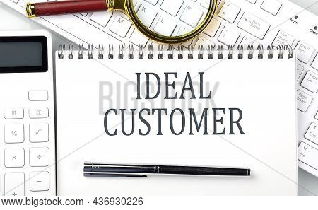 Ideal Customer Text On The Notepad With Calculator And Keyboard,business Concept